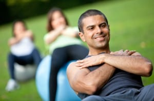 Group of people in a pilates class outdoors